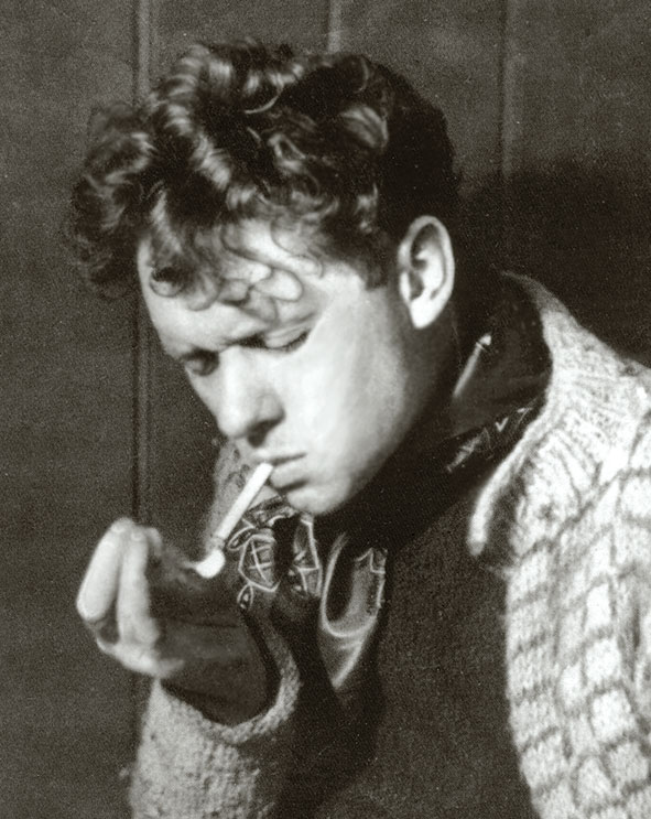 Dylan Thomas lighting a cigarette