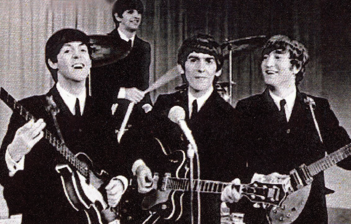 Music band The Beatles playing their instruments in black and white