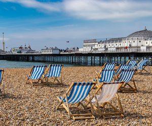 Deckchairs on Brighton beach in front of Brighton Pier
