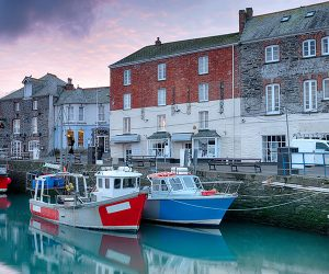 Boats on the water in a North Cornwall town
