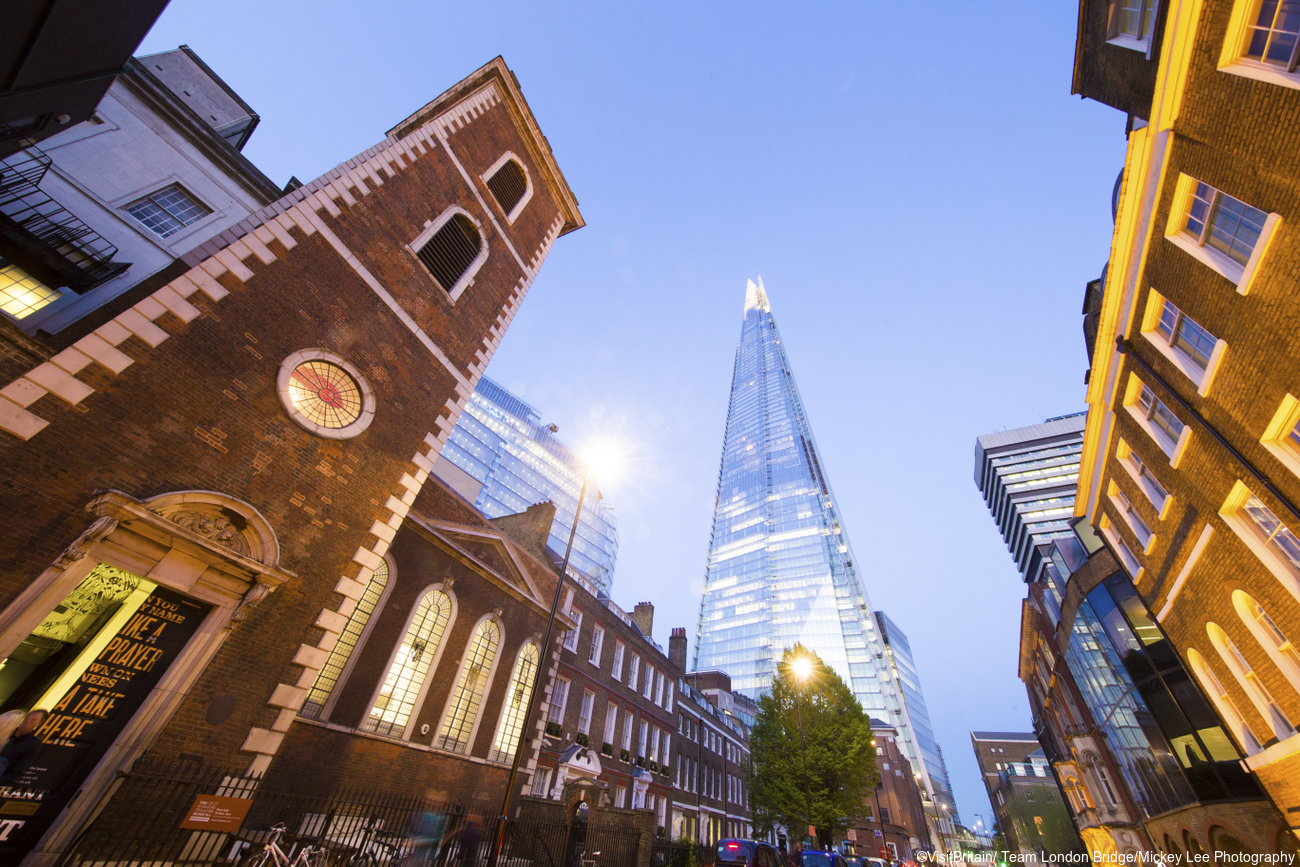 Historic buildings of Southwark and St Thomas's church tower, and a view of the Shard tower looming over the streets.
