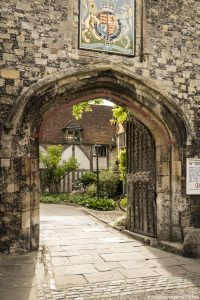 A gate in the city walls and the entrance to Winchester cathedral