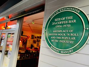 Green plaque for the legendary 2i's Coffee Bar