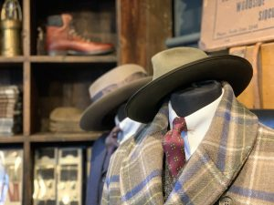 A display of hats and jackets and ties in Thomas Farthing, Museum Street