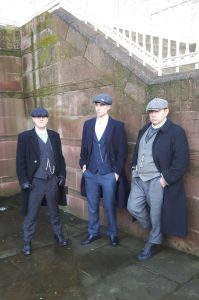 3 men dressed as 'Peaky Blinders'