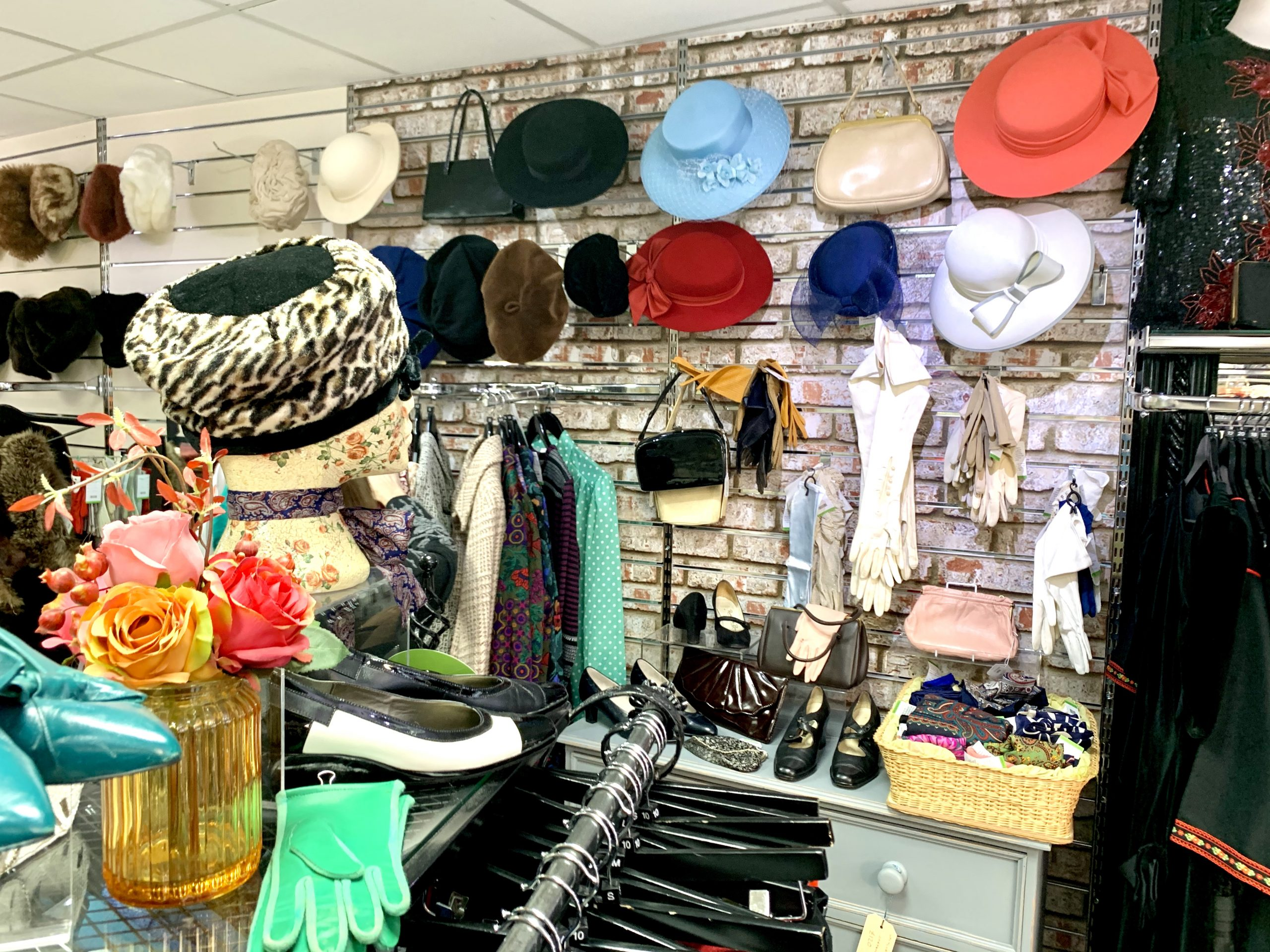 Hats and gloves on display in a vintage shop