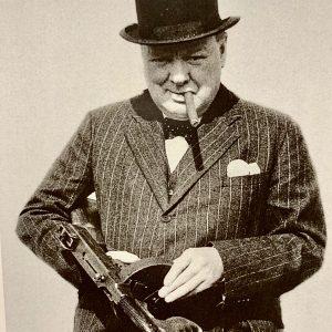 Photograph of Winston Churchill holding a gun