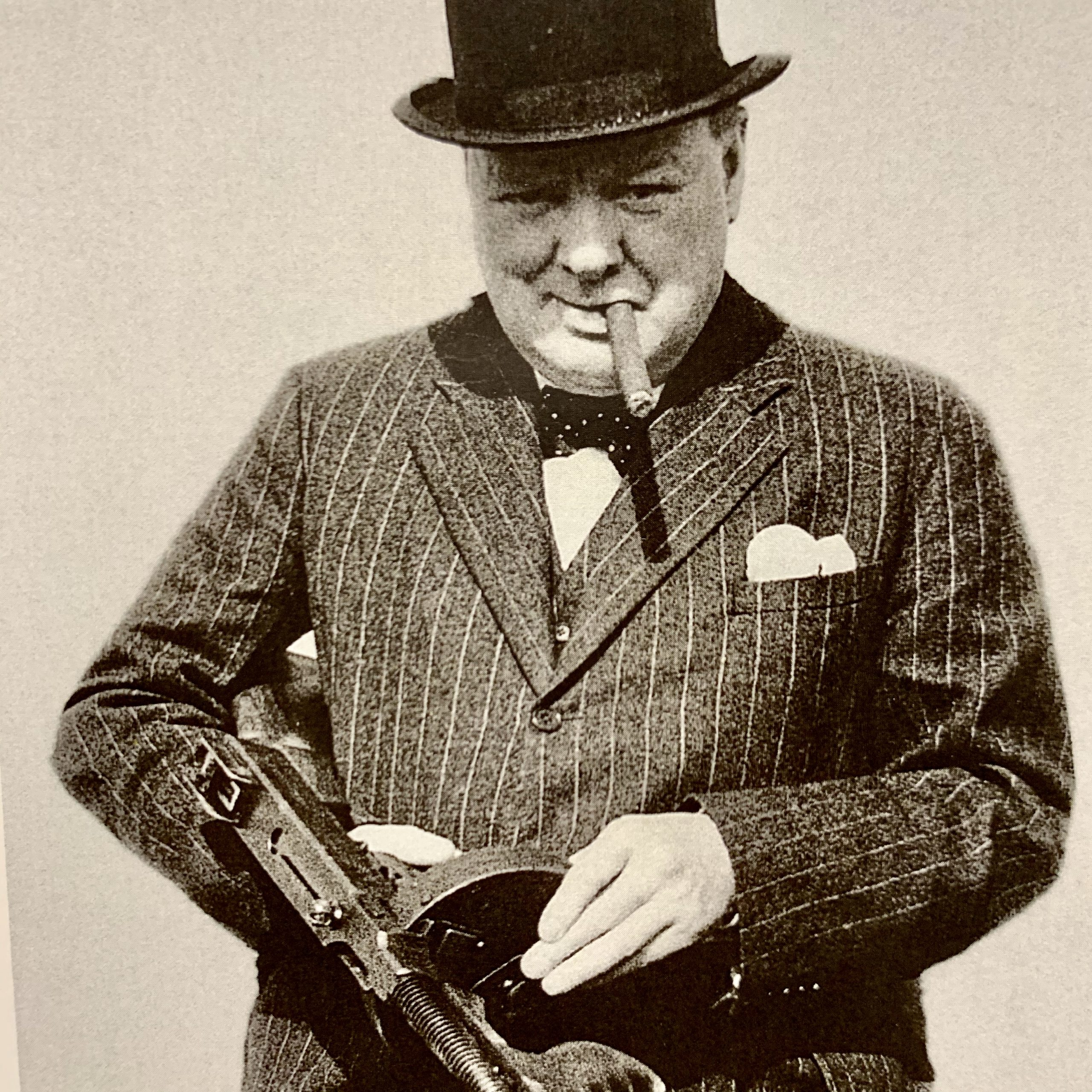 Photograph of Winston Churchill holding a gun