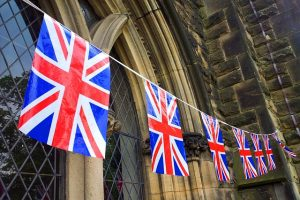 Union Jack bunting across an old building
