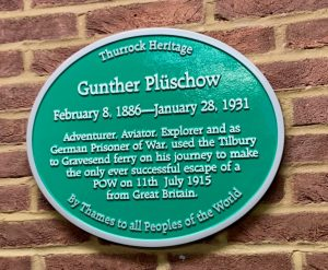 A green plaque Plaque in Tilbury Port commemorating escaped German POW Gunther Plüschow.