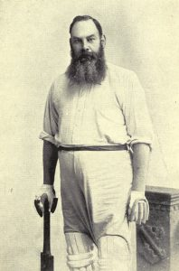 Black & White image of man in cricket whites with a big beard
