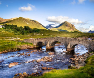 Old stone bridge over a river in the Highlands, Scotland